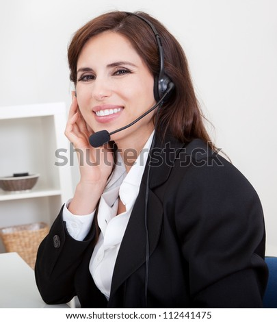 Young Cheerful Smiling Support Phone Female Operator In Headset At Office.