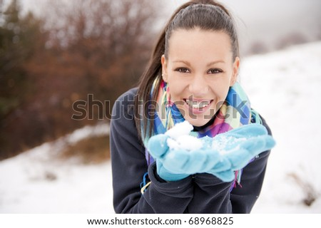 Young cheerful woman outdoors in winter - stock photo