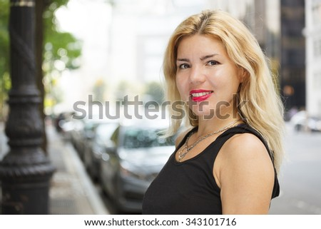 Young cheerful woman smiles. - stock photo