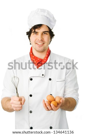 young chef holding a fresh eggs on white background - stock photo