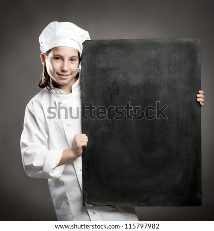 young chef holding menu chalkboard - stock photo