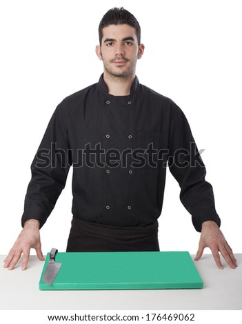 Young chef ready on white background - stock photo
