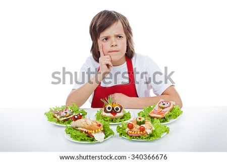 Young chef thinking about the next creative sandwich idea to make - isolated - stock photo