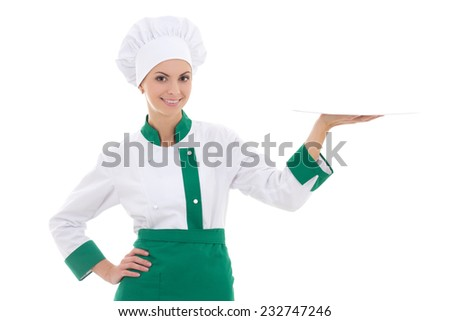 young chef woman in uniform with empty plate isolated on white background - stock photo