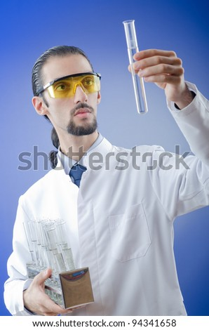 Young chemist student working in lab