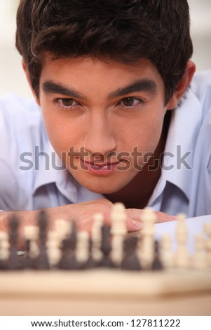 young chessplayer looking focused