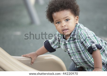 Young child at a playground - stock photo
