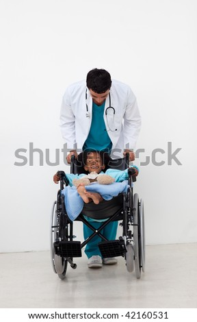 Young child being cared for by a doctor in a hospital - stock photo