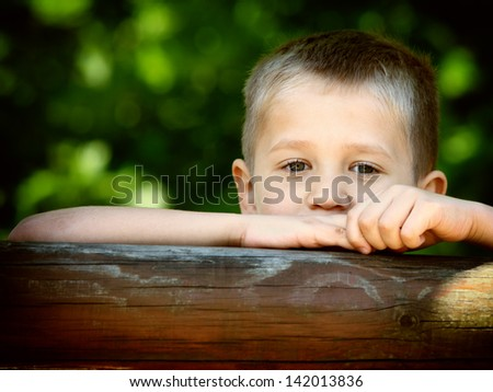 young child boy or kid playing in playground on leisure equipment - stock photo