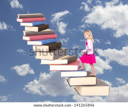 young child climbing a staircase of books with a cloudy background