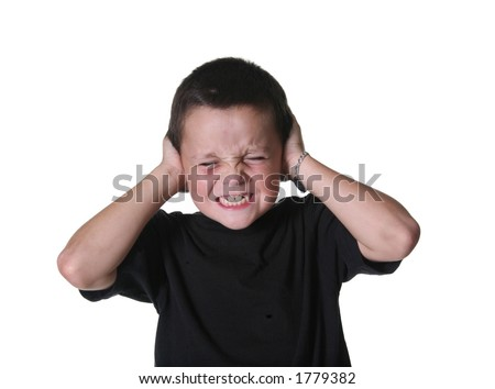 Young Child Covering Ears From Loud Noise
