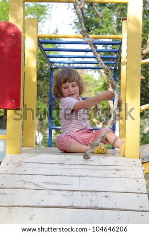 young child enjoying free time on playground