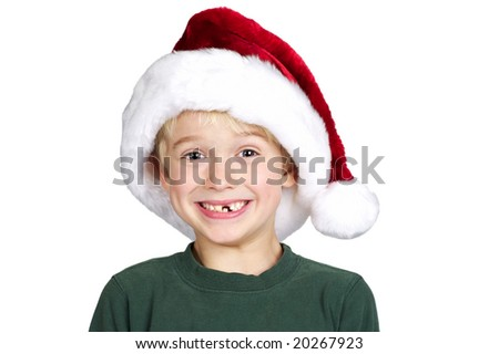 Young child excited for Christmas in a santa hat and big toothless smile - stock photo