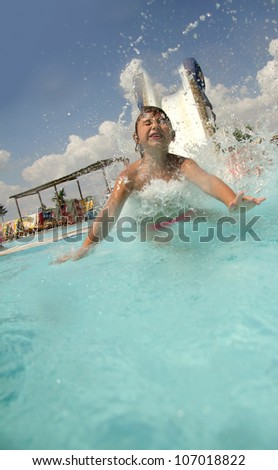 young child having fun in aquapark - stock photo
