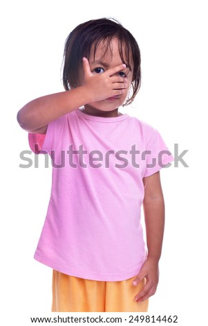 Young child hiding his face. - stock photo