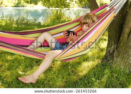 Young child in a hammock - stock photo
