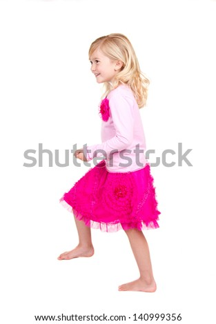 Young child in the action of stepping up isolated on white