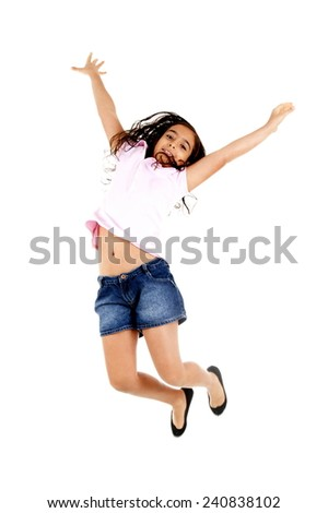 Young child jumping over white background . - stock photo