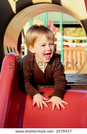 Young child on slide - stock photo