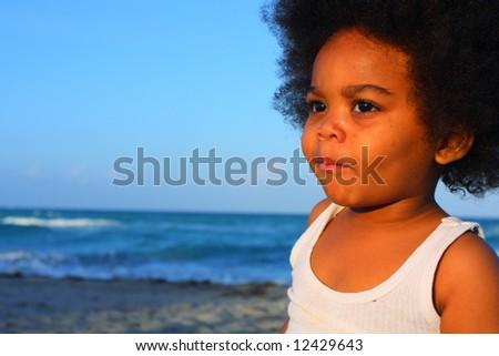 Young child smirking - stock photo