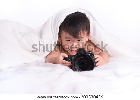 young child with digital SLR camera on neutral background - stock photo