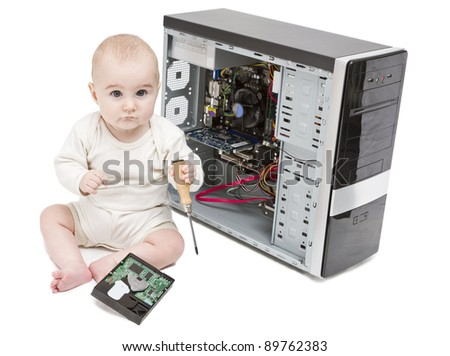 young child with screwdriver in hand working on open computer in white background. hard disk laying around