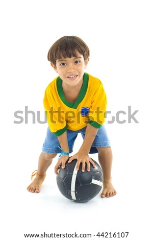 Young Child with Yellow Brazil T-shirt and a ball . - stock photo