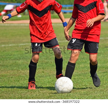 Young children are playing soccer - stock photo