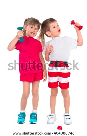 Young children with dumbbells perform gymnastic exercises on a white background - stock photo