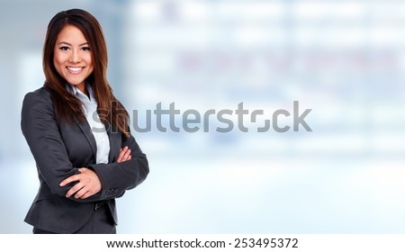 Young chinese Business woman over office background - stock photo