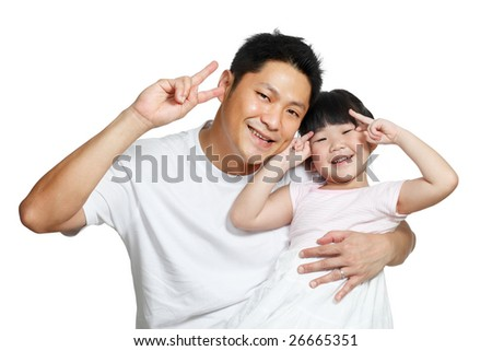 Young Chinese father posing with daughter making victory signs with their hands, happily smiling looking at camera - stock photo