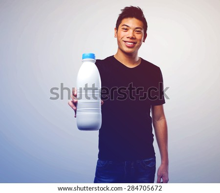 Man drinking milk stock images royalty free images vectors young chinese man drinking milk sciox Gallery