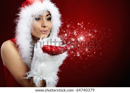 young christmas woman holding star over red background - stock photo