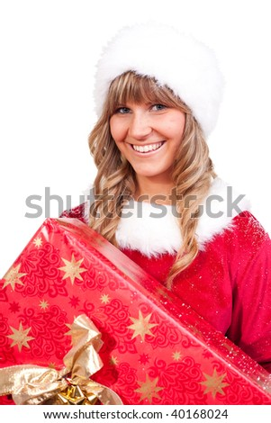 young christmas woman in red santa claus dress is holding a huge present - stock photo