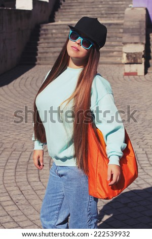 Young chubby woman in cap. Lifestyle portrait. Photo toned style Instagram filters. - stock photo