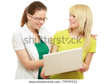 Young college girls with a laptop, isolated on white - stock photo
