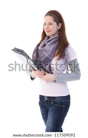 Young college student going to class with folders. - stock photo