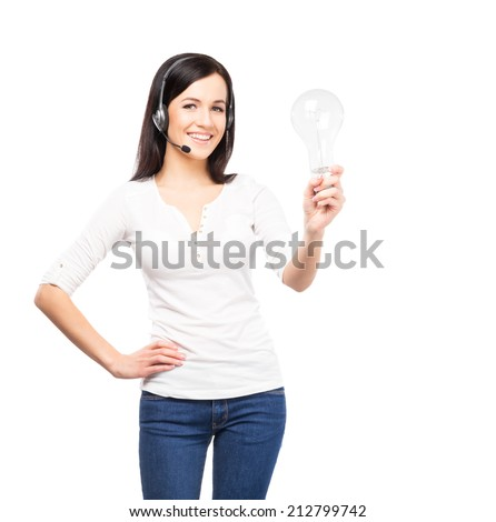 Young, confident and smiling customer support operator with a bulb lamp. Idea concept. - stock photo