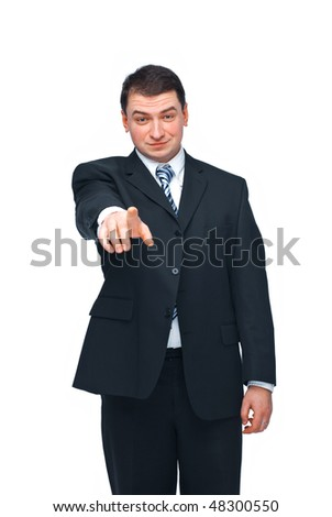 Young confident business man pointing to you isolated on white background