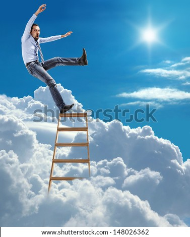 young confident businessman standing at the ladder high in the sky falls from the top / young man in shirt and tie extends slipped and falls from the top of ladder  - stock photo