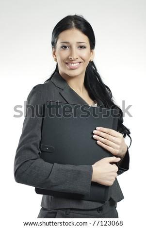 young confident businesswoman holding black portfolio - stock photo