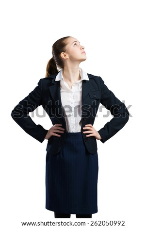 Young confident businesswoman with arms on waist isolated on white - stock photo