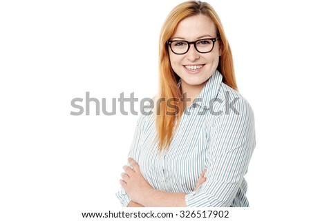 Young confident lady with arms crossed