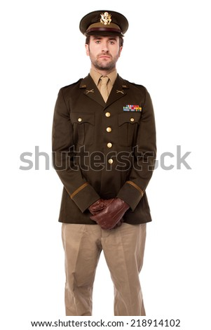 Young confident military man posing - stock photo