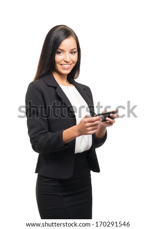 Young, confident, successful and beautiful business woman with the mobile phone isolated on white