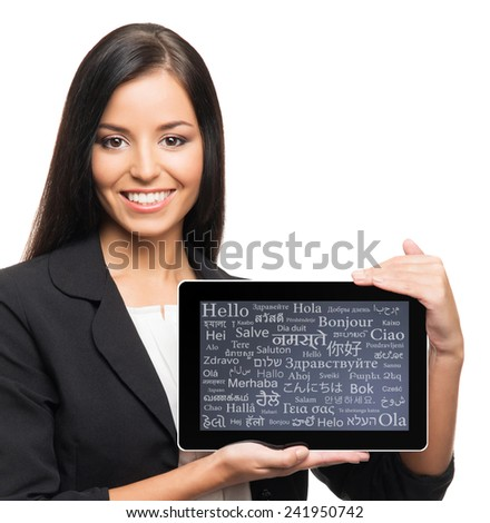 Young, confident, successful and beautiful business woman with the tablet computer with a different world languages on a display - stock photo
