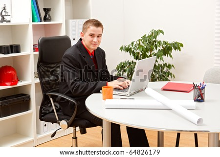 Young construction business man in his office - stock photo
