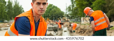 Young construction worker is very tired after work