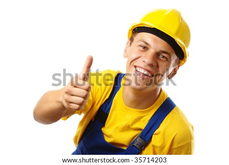 Young construction worker showing thumb up sign, isolated over white - stock photo