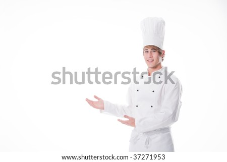 Young cook showing something - stock photo